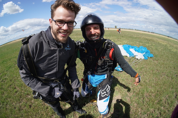 tipping in skydiving Happy Tandem Skydiving Instructor with Student