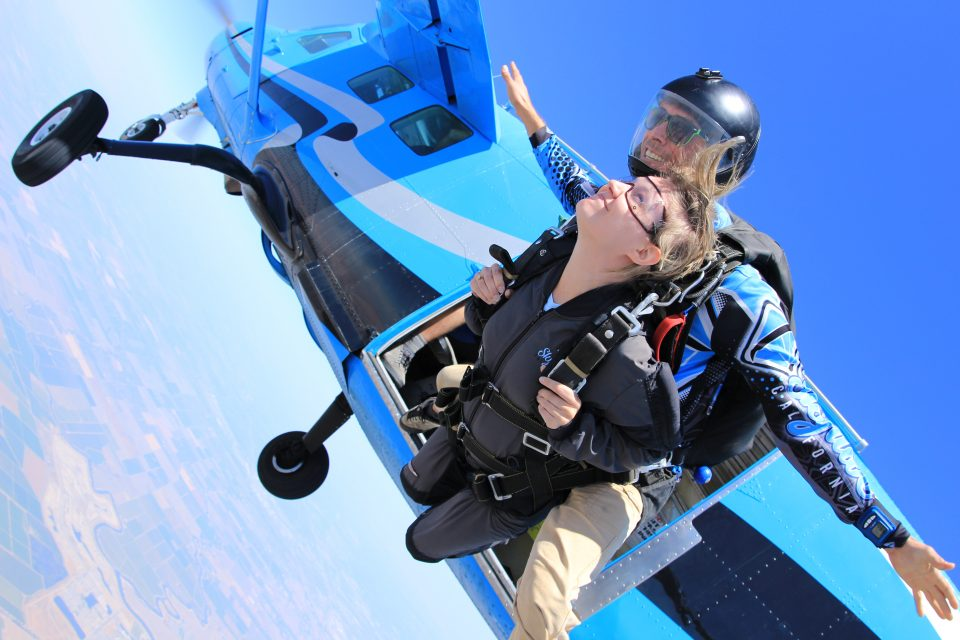 Tandem skydiver takes the leap from Skydive California air craft into free fall.