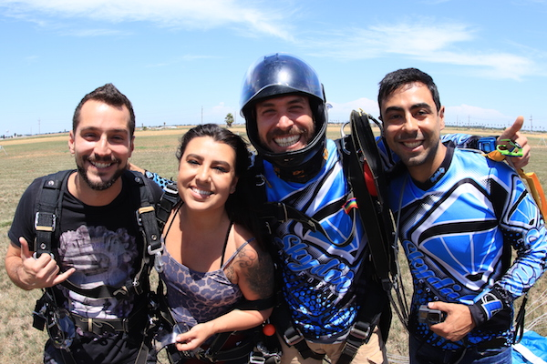 Tandem Skydiving Students and Instructors after landing