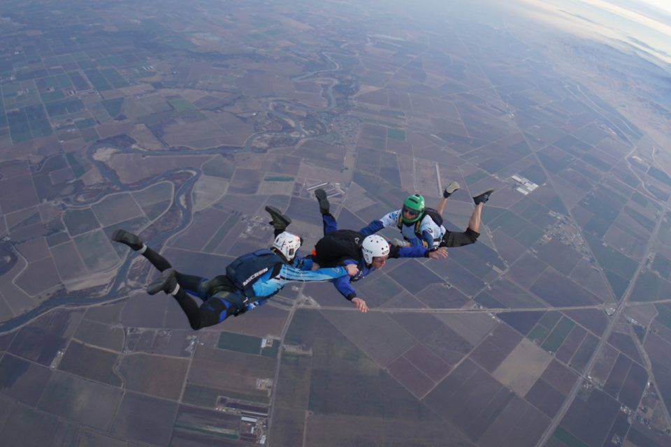 AFF student in free fall with two instructors.