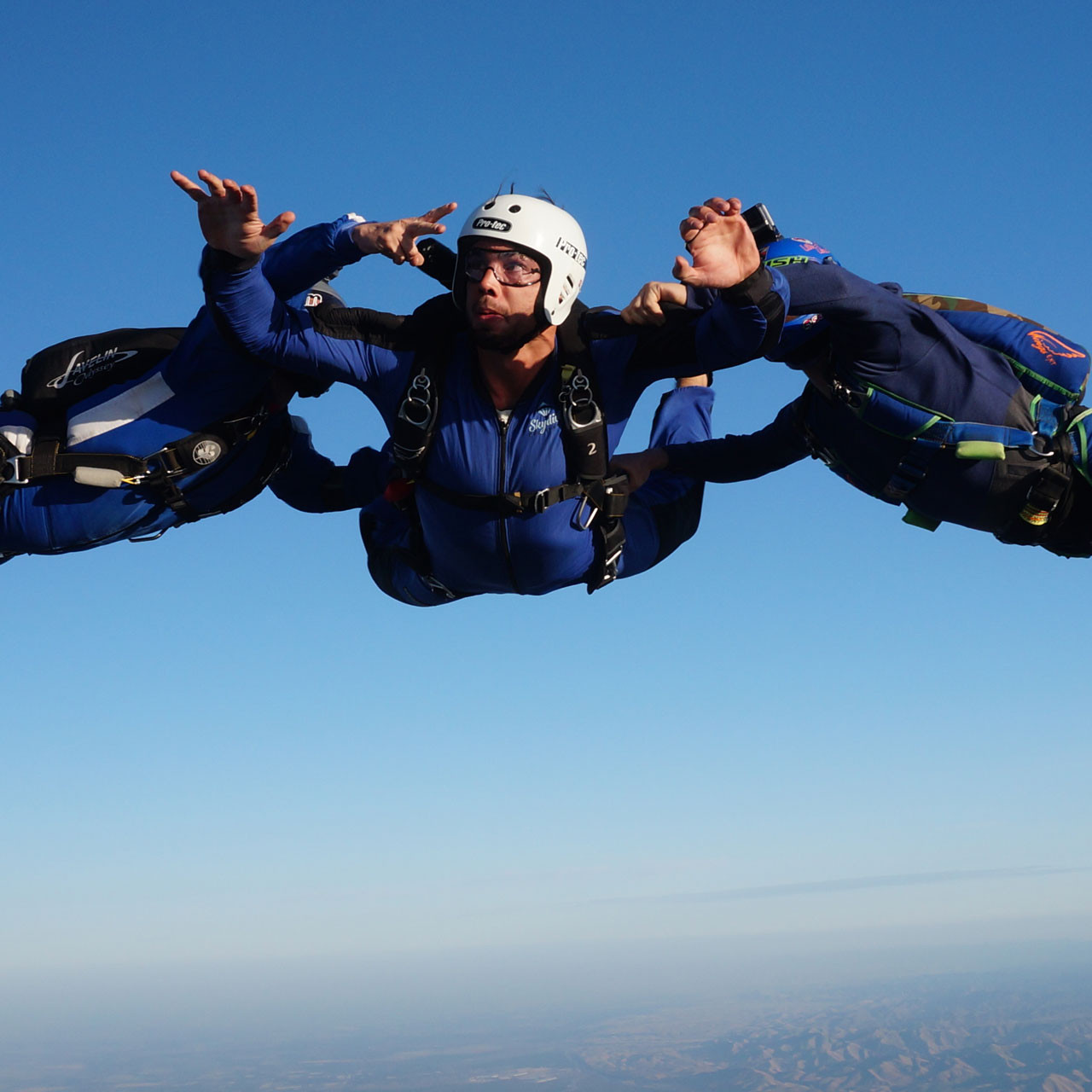 Male AFF student in free fall during training at Skydive California.