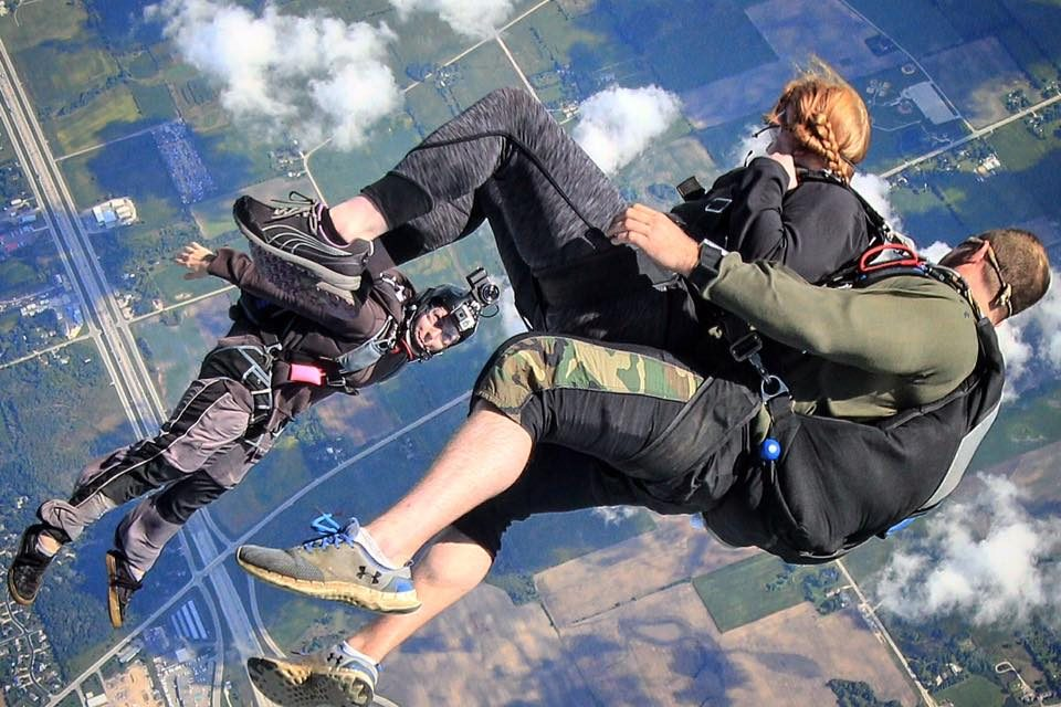 Tandem skydiver and instructor in freefall