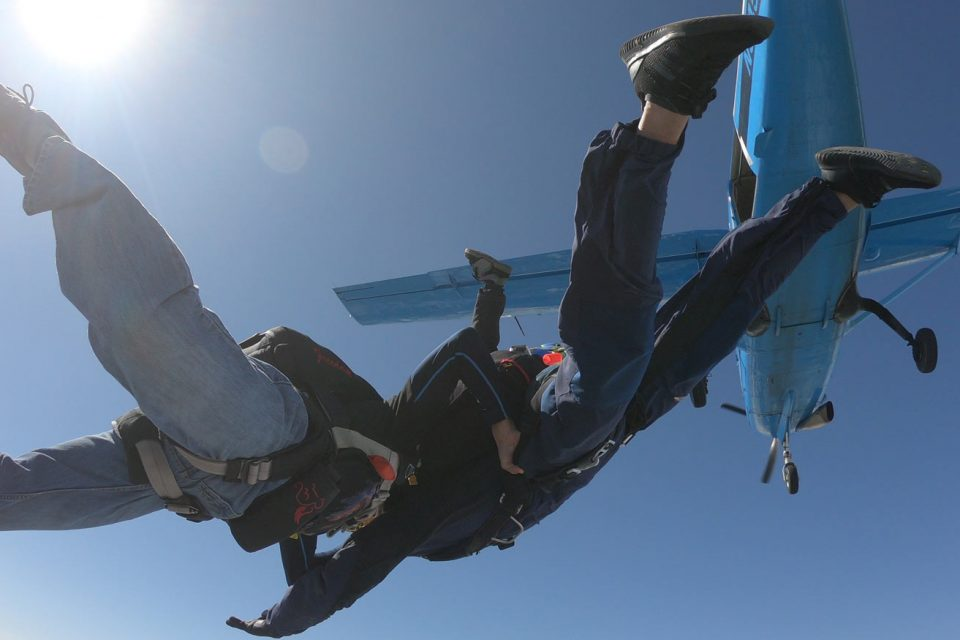 Two experienced jumpers in free fall at Skydive California.