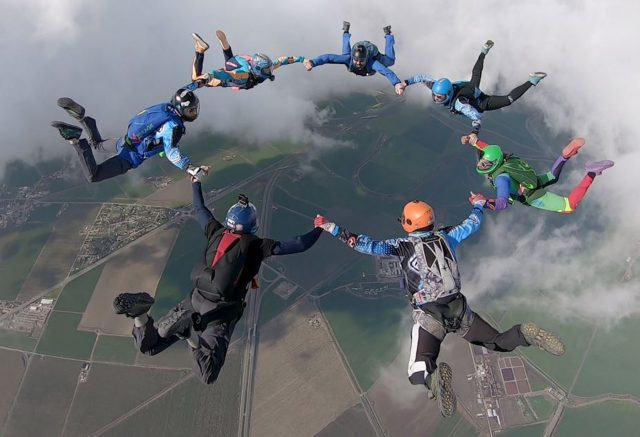 Experienced skydivers in 7-way formation at Skydive California.