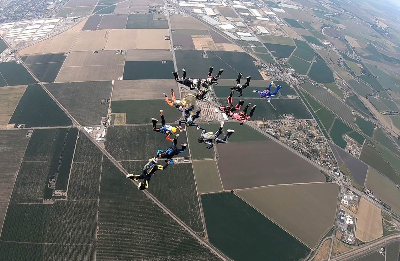 Experienced skydivers in formation at Skydive California.