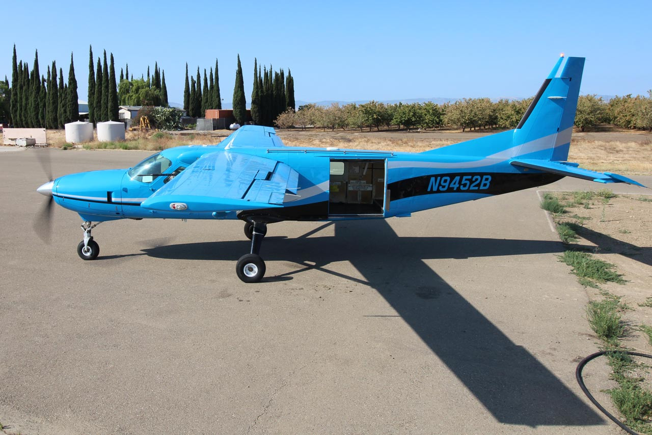 Skydive California's blue air craft.