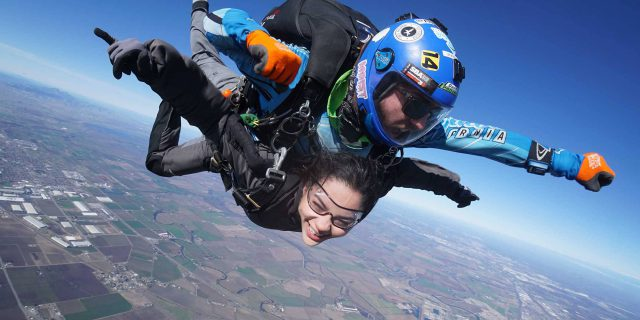 Female tandem skydiver excited to be in free fall