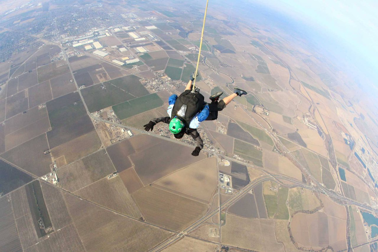 Tandem instructor for skydive cal in free fall with a student