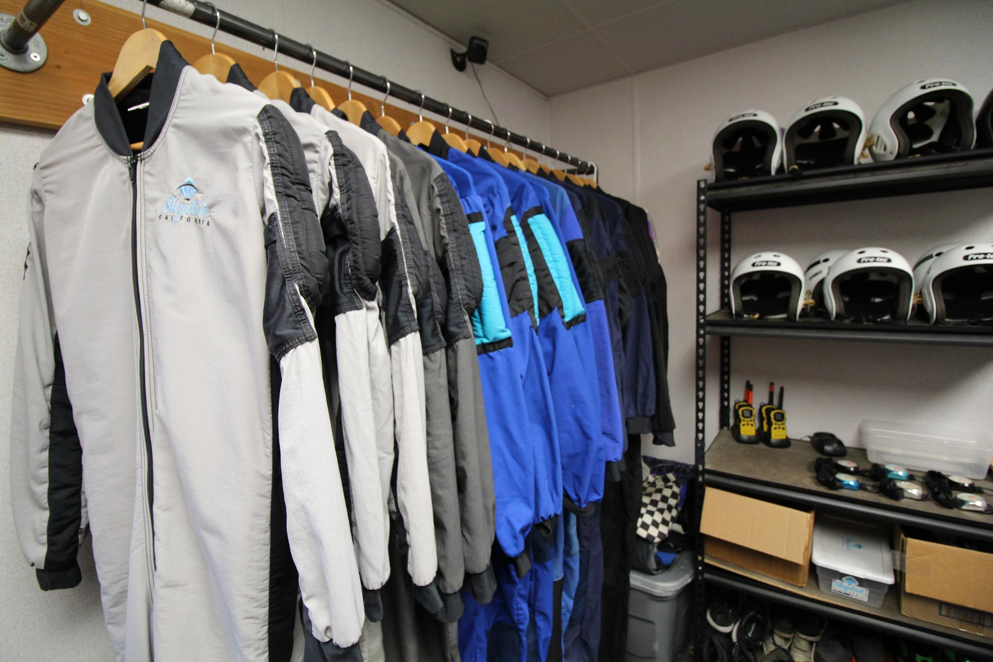 Skydive California jumping gear including suits and helmets.